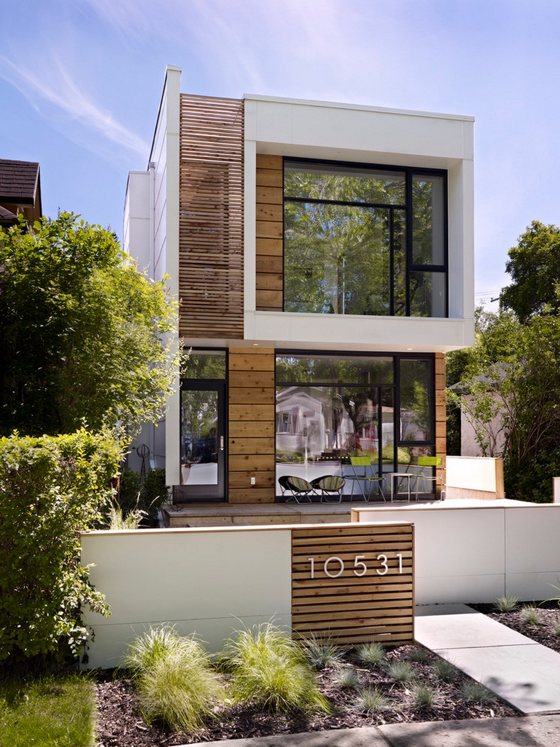 Deceitfully small thin house looks small on the outside for Big modern house designs