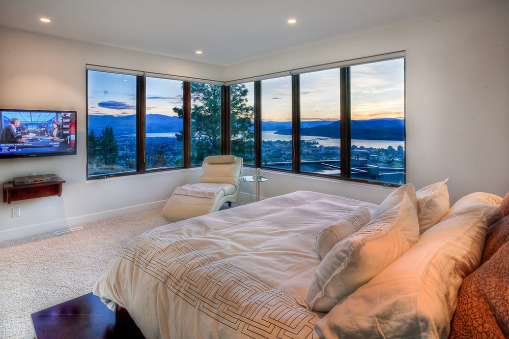Bedroom With Corner Window And Amazing City View