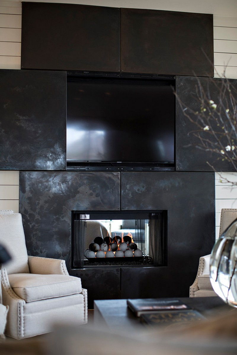 blackened stainless steel and tv cabinet over fireplace