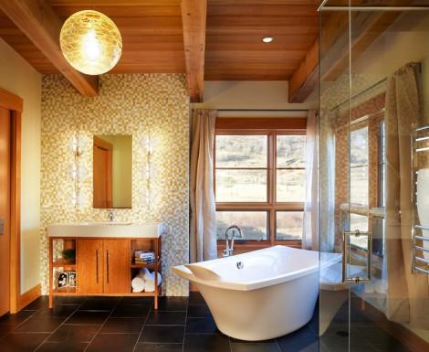 Interesting contrasts of light walls and black floor tiles in bathroom
