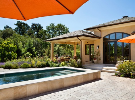 arched windows and rectangular pool