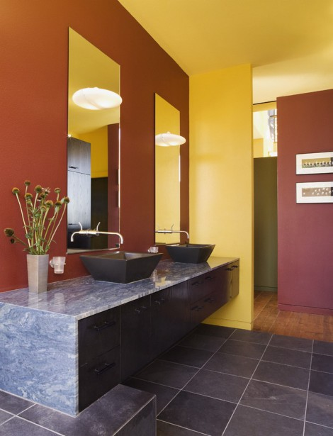 brightly coloured bathroom with double basin and marble granite tops