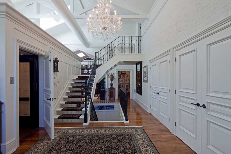 classic 3 story chandelier with impressive use of space
