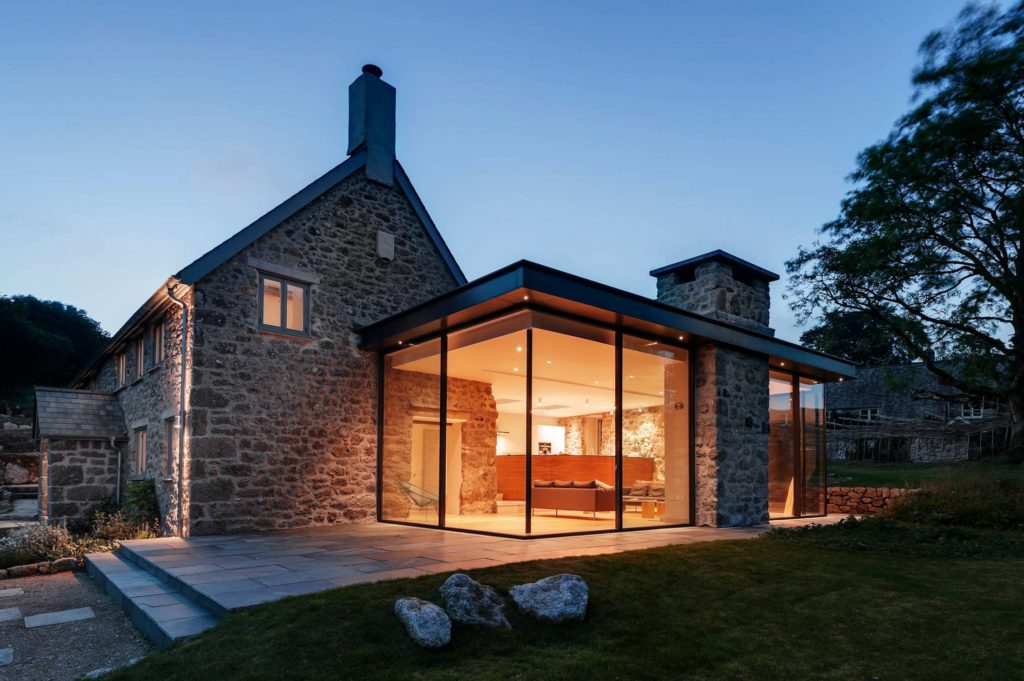 classic stone farmhouse with modern glass extension
