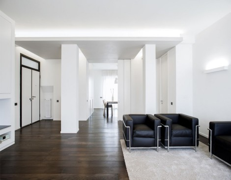 dark wood floors with white walls
