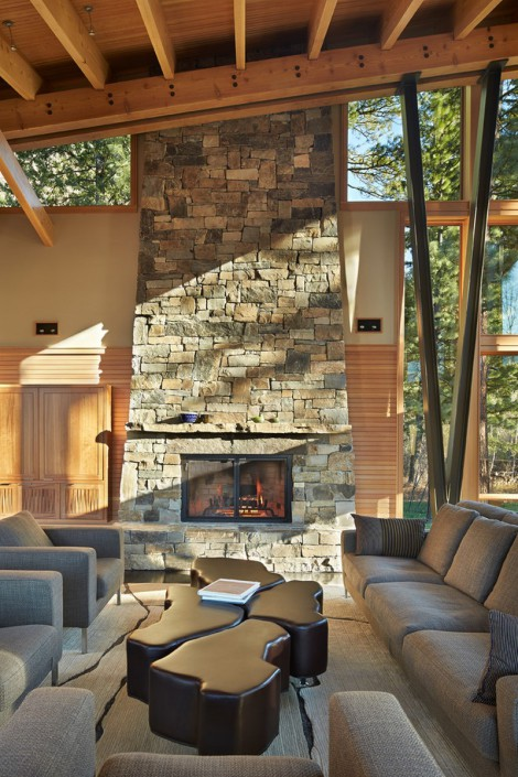 floor to ceiling glass and stone fireplace
