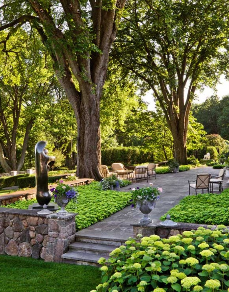 garden space with trees and sculpture