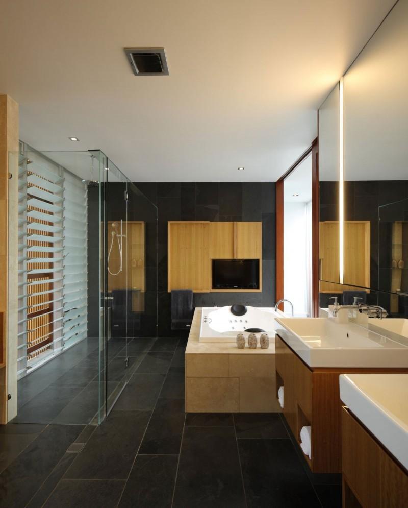 grey slate bathroom with modern light bath and walk in shower