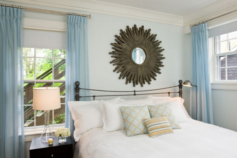 light blue bedroom with funky mirror