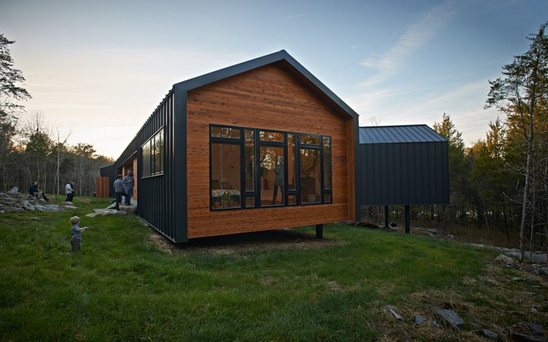 metal and cedar l shaped house