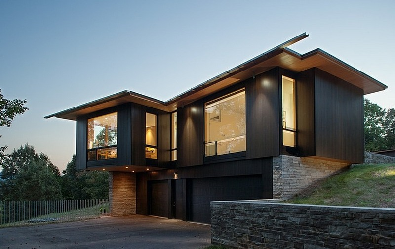 modern black house on a mountain lake