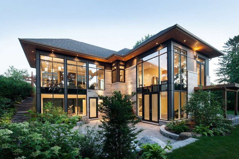 modern home with many windows 2 story
