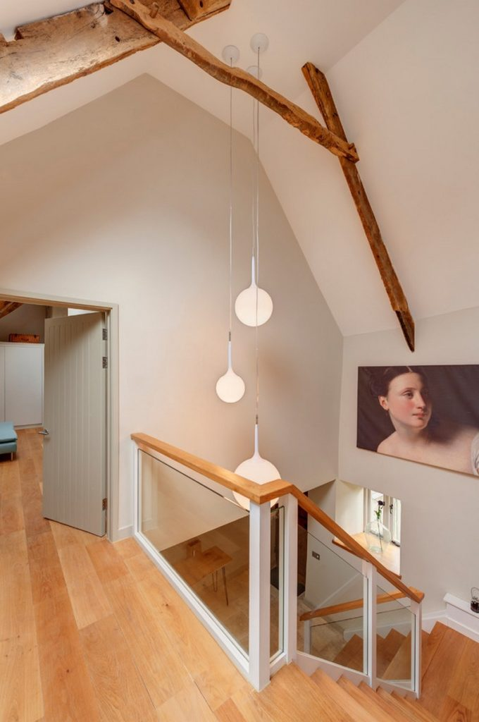 natural wood beams with pendant lights on staircase