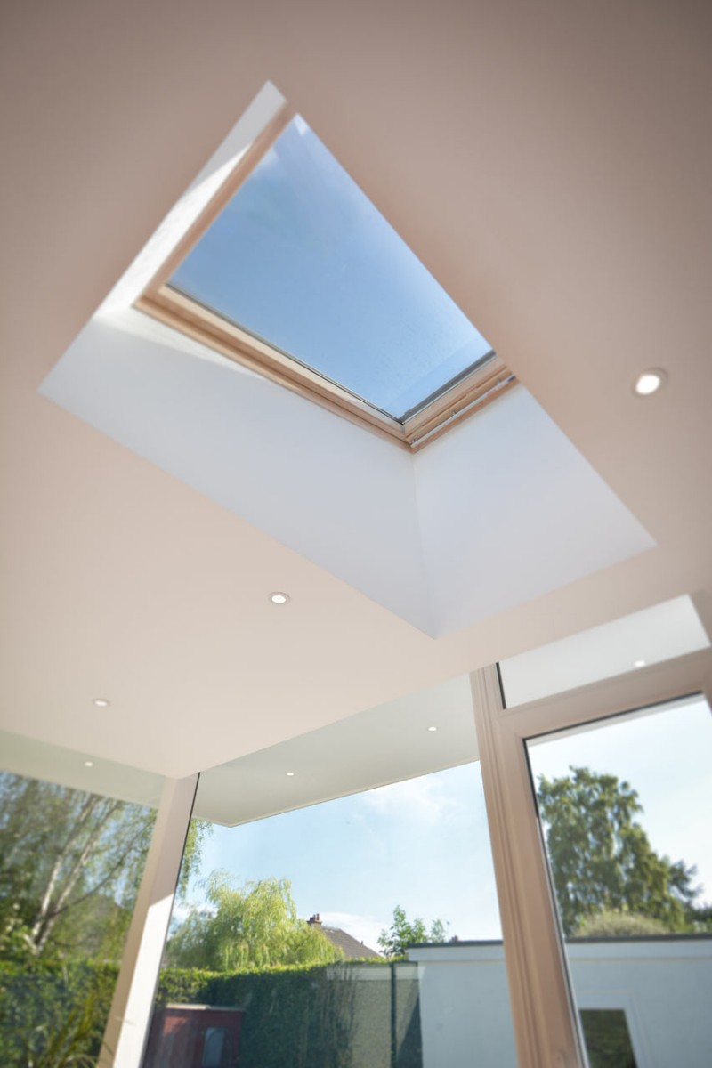 English home with contemporary sun room Ceiling window