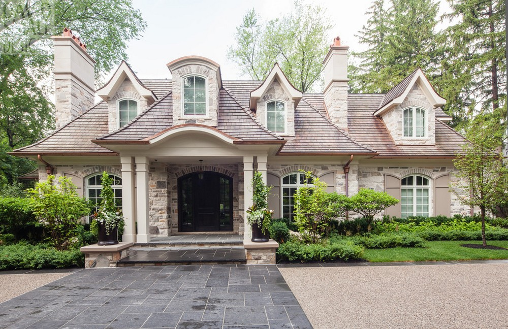 Dormers stone accents above windows with shutters chimney with