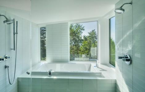 white glass tile in the modern master bedroom