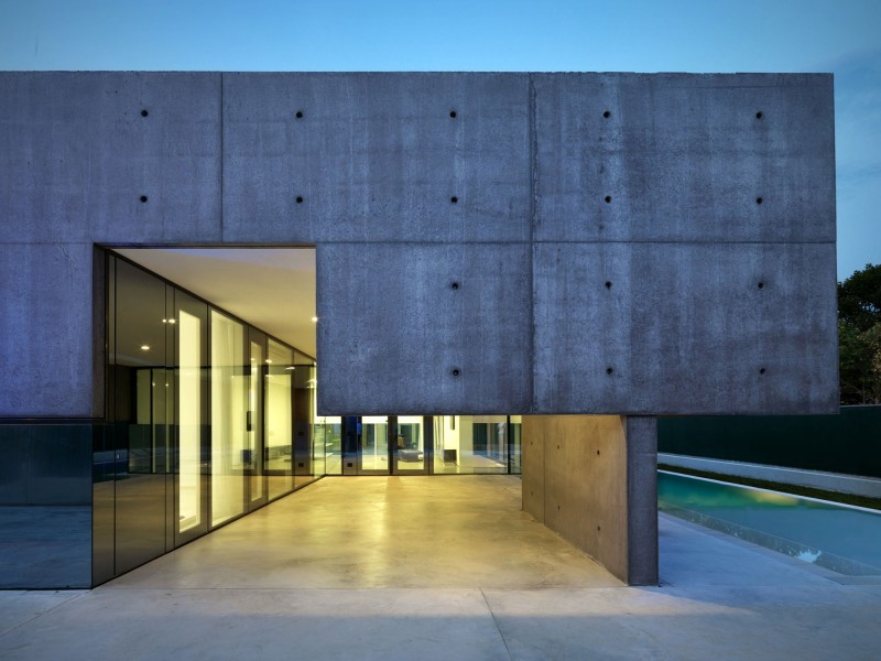 concrete home with pool