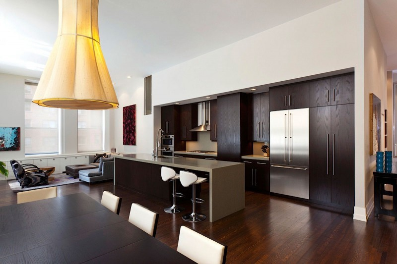 functional kitchen space with interesting light fitting