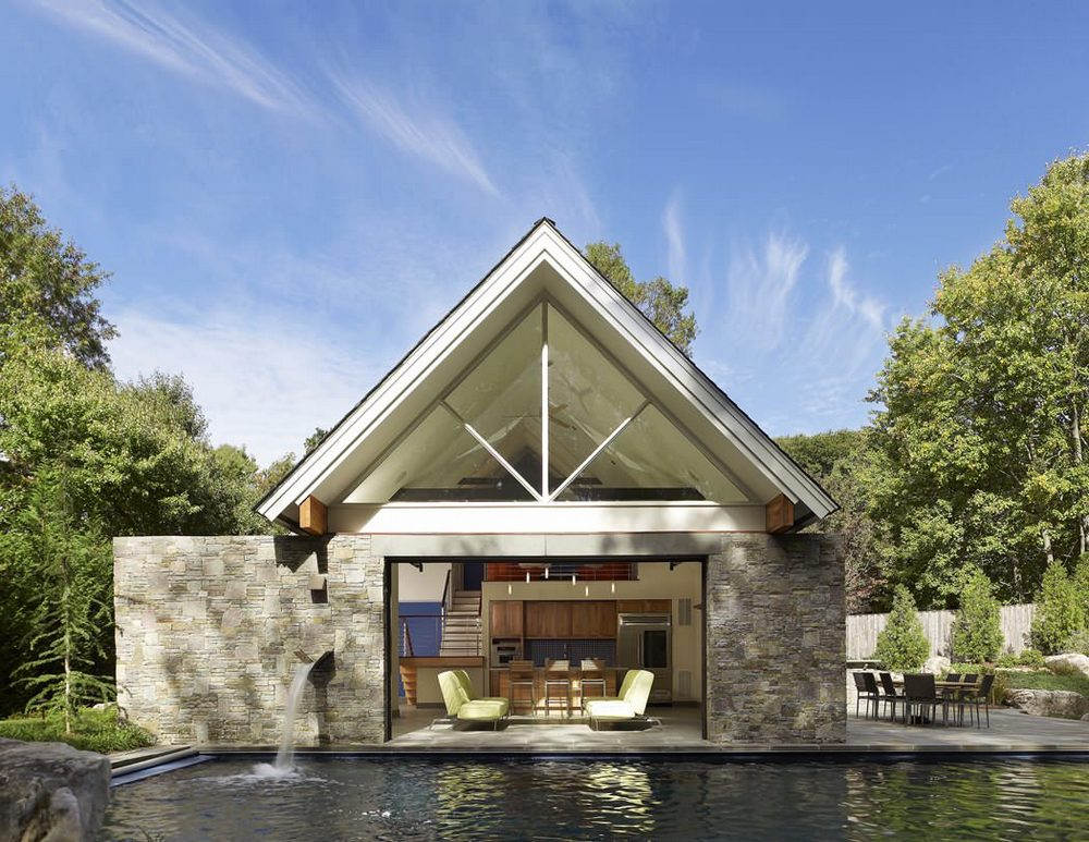 Pool house that opens via large glass garage door for Home plans with pools
