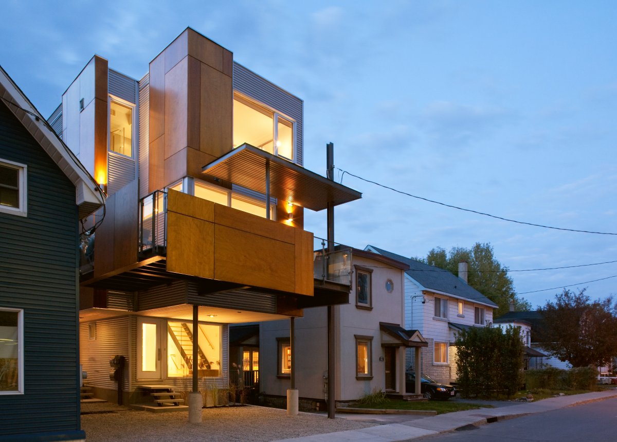 Slim style narrow house is a masterpiece of fine modern for Modern tower house designs