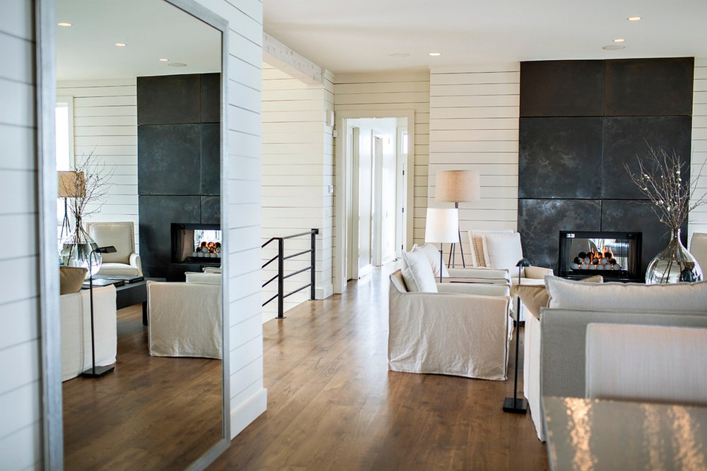big mirror on the floor and white horizontal siding in the