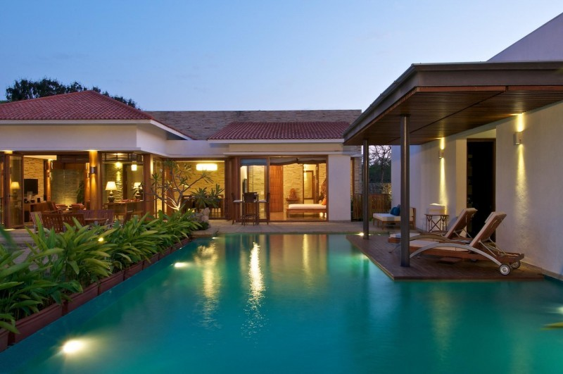 beautiful swimming pool in front of the house