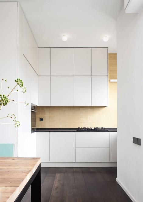 white kitchen with beige backsplash